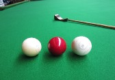 Ivory billiard balls with antique mace