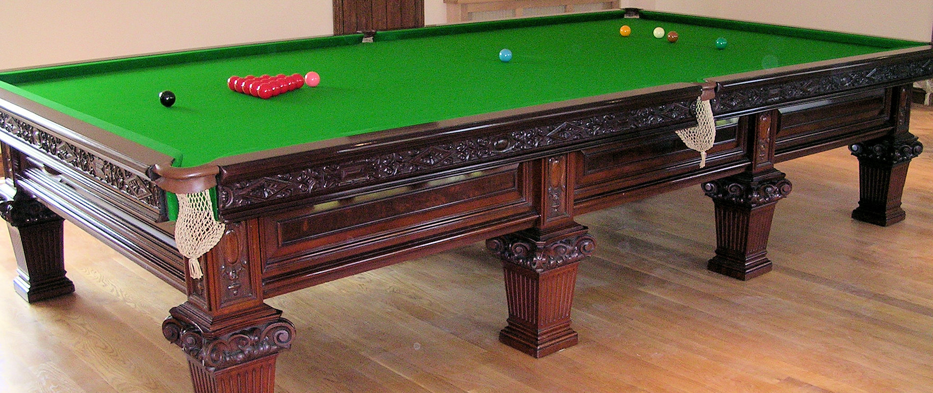 Full Size Billiard table by Riley, carved mahogany